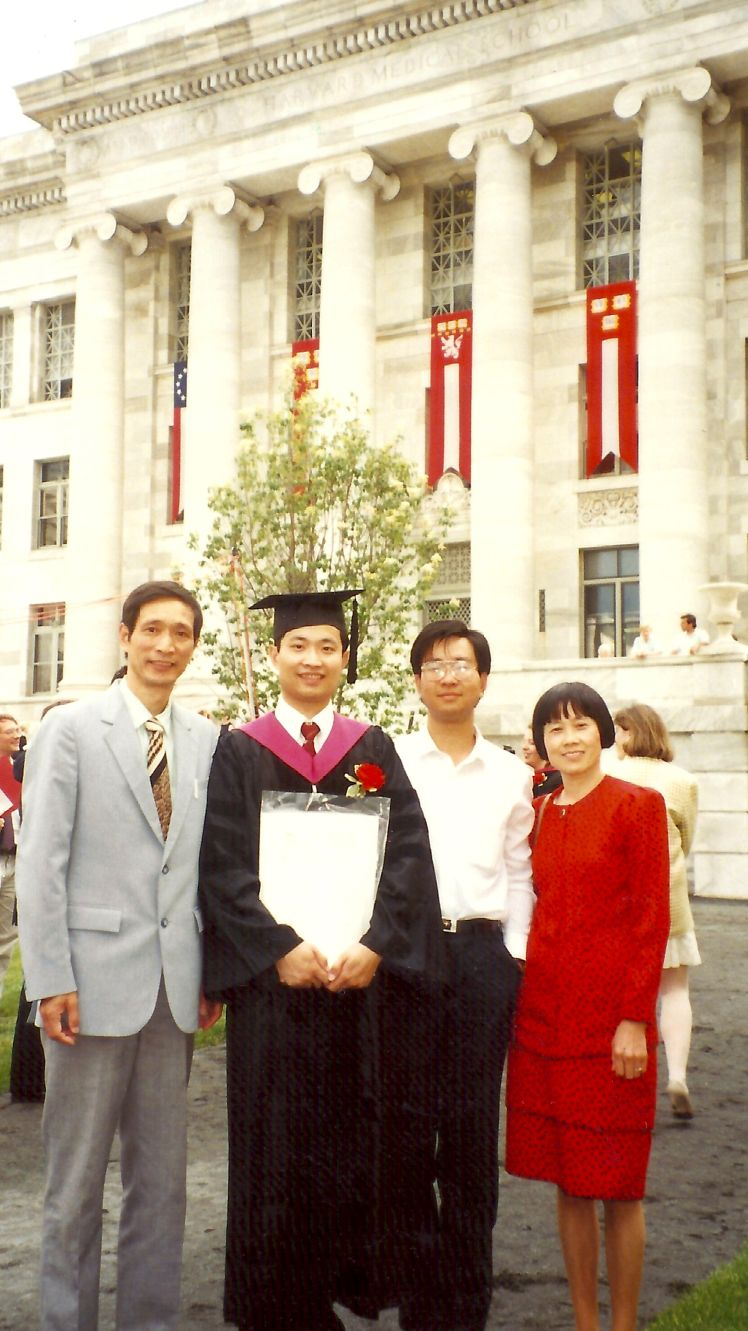 6 4. With my parents and brother Ming yu at gradu